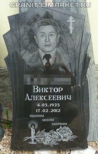 Памятник из гранита с портретом, свечкой, крестиком и цветами